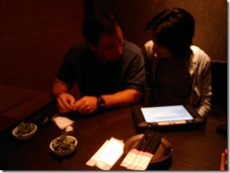 Erik and Chieko look over the menu